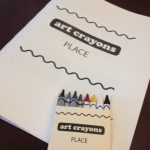 The entire toolkit: crayons, packaging, and workbook