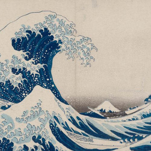 A Japanese woodcut print of a massive wave engulfing a mountain peak in the background. Artwork credit: Under the Wave off Kanagawa by Hokusai aratame Iitsu hitsu