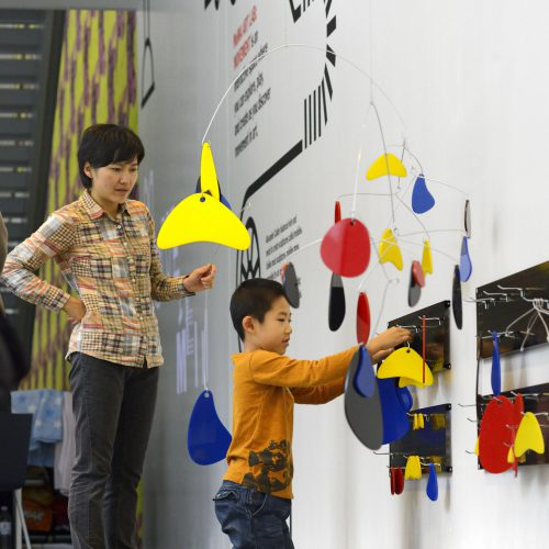 A child and mother recreate an Alexander Calder mobile in MoMA Art Lab